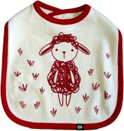 Baby Bib, white with red surround. Depicts a childs hand drawn image of a sheep standing in the grass