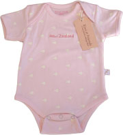 Pink Baby Romper with little white Kiwis dotted all over it