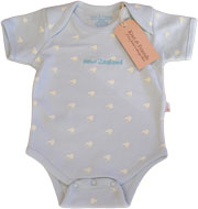 Blue Baby Romper with little white Kiwis all over it