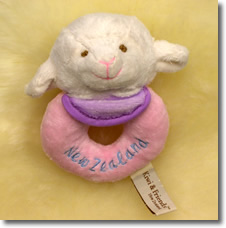 Smooth velvity white sheep head with pink rattle attached