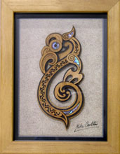Maori carvings of Maniaia in picture frame
