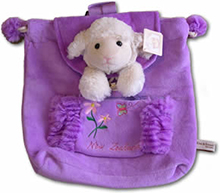 Purple Backpack with toy sheep attached to back